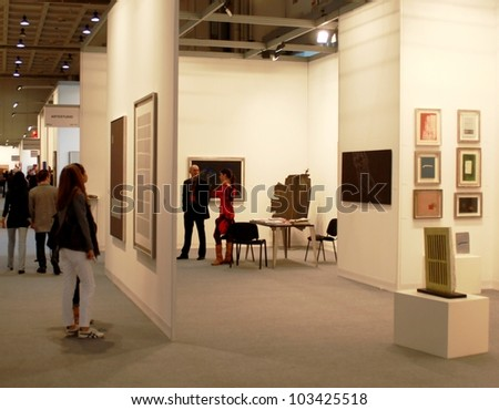 MILAN - MARCH 27: People look at paintings galleries during MiArt ArtNow, international exhibition of modern and contemporary art March 27, 2010 in Milan, Italy. - stock photo