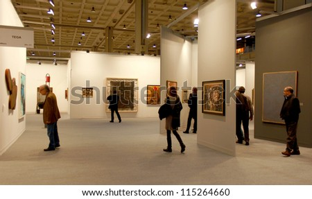 MILAN - MARCH 27: People visit paintings galleries during MiArt ArtNow, international exhibition of modern and contemporary art March 27, 2010 in Milan, Italy. - stock photo