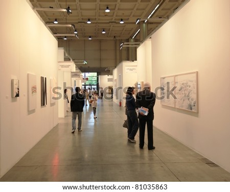MILAN - MARCH 27: People visit sculpture and paintings galleries during MiArt ArtNow, international exhibition of modern and contemporary art March 27, 2010 in Milan, Italy - stock photo