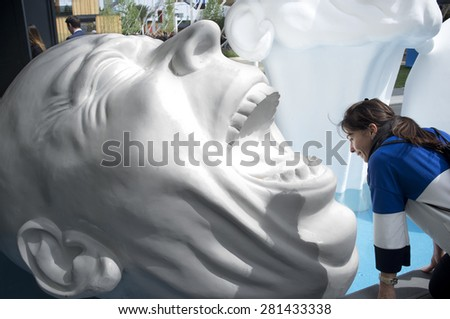 Milan - May 20, 2015 - Milan Expo 2015, exterior detail of Slovakia pavilion with smiling female visitor - stock photo