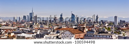 Milan, new panoramic skyline. The picture was taken from the Duomo cathedral and shows the new buildings from the Garibaldi district. The alps, less than 50 miles away, are on the background. - stock photo