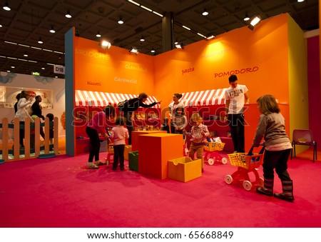 MILAN - NOV 21: Iper Kids stand at G! Come Giocare 2010, International Toy Fair, in Milan Fair, Nov 21, 2010. - stock photo