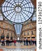 MILAN - NOVEMBER 15: Galleria Vittorio Emanuele II - shopping mall includes shops, restaurants and bars. Named after king of Italy, originally designed in 1861 in Milan, Italy on November 15, 2009. - stock