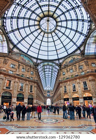 MILAN - NOVEMBER 15: Galleria Vittorio Emanuele II - shopping mall includes shops, restaurants and bars. Named after king of Italy, originally designed in 1861 in Milan, Italy on November 15, 2009. - stock photo