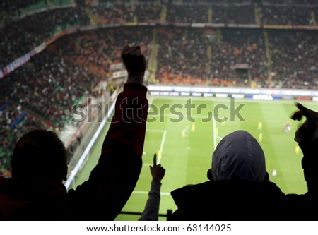 MILAN-OCTOBER 16: Supporters cheer their team after a goal at Italian Championship soccer game, AC Milan - Chievo on October 16, 2010 in Milan - stock photo