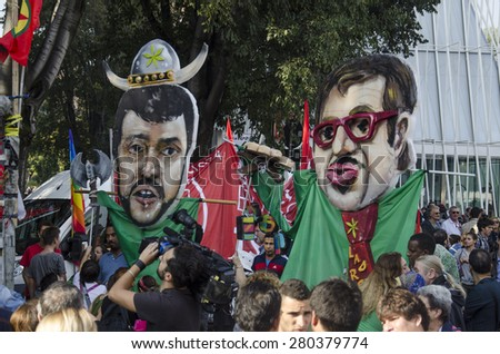 Milan, october 18, 2014 - The Caricature of Matteo Salvini, secretary of the Lega Nord and Roberto Maroni, President of Lombardy, held by protesters during the march against Lega Nord. - stock photo