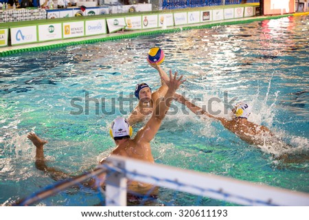 MILAN, SEPTEMBER 20: A. Di Fulvio  ( Blue cap BPM Sport M.) in game BPM Sport Management  vs. Jadran Carine in  Len Champions League on September 20, 2015 , Milan ( Italy).