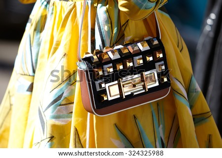 MILAN - SEPTEMBER 24: Anna dello Russo poses for photographers before Fendi show with Fendi bag during Milan Fashion Week Day 2, Spring / Summer 2016 street style on September 24, 2015 in Milan. - stock photo
