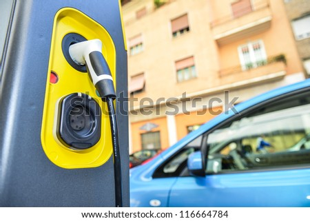MILAN - SEPTEMBER 13: Electric vehicle in car sharing station. This innovative service allows to pick up and deposit cars in various parking areas around the city, on September 13,2012 in Milan, Italy - stock photo