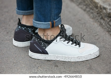 MILAN - SEPTEMBER 22: Man with black and white Hogan rebel shoes before Max Mara fashion show, Milan Fashion Week street style on September 22, 2016 in Milan.