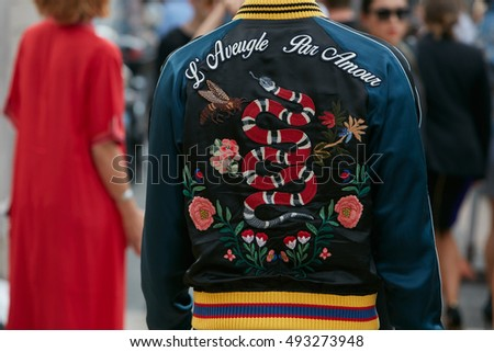 MILAN - SEPTEMBER 23: Man with Gucci bomber jacket 'Blind by love' with snake and floral decoration before fashion Tod's show, Milan Fashion Week street style on September 23, 2016 in Milan.