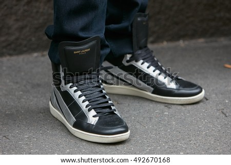 MILAN - SEPTEMBER 22:Man with Saint Laurent black and silver sneakers before Max Mara fashion show, Milan Fashion Week street style on September 22, 2016 in Milan.