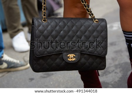 MILAN - SEPTEMBER 21: Woman with black Chanel bag before Wunderkind fashion show, Milan Fashion Week street style on September 21, 2016 in Milan.