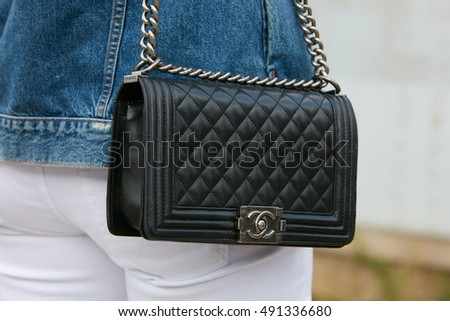 MILAN - SEPTEMBER 21: Woman with black Chanel leather bag before Gucci fashion show, Milan Fashion Week street style on September 21, 2016 in Milan.