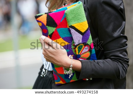 MILAN - SEPTEMBER 23: Woman with colorful fabric bag before fashion Tod's show, Milan Fashion Week street style on September 23, 2016 in Milan.