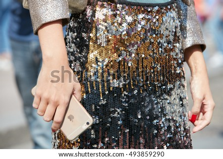 MILAN - SEPTEMBER 25: Woman with golden, silver and black sequins pattern before Stella Jean fashion show, Milan Fashion Week street style on September 25, 2016 in Milan.