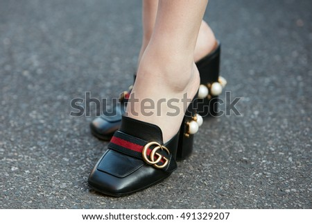 MILAN - SEPTEMBER 22: Woman with Gucci shoes with pearl decoration before Prada fashion show, Milan Fashion Week street style on September 22, 2016 in Milan.