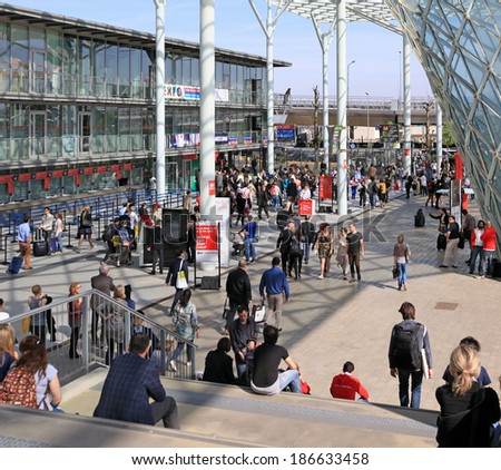 MILANO - APRIL 10, 2014: People at the entrance of Salone del Mobile, international home furnishing and accessories design exhibition in Milano, Italy.  - stock photo