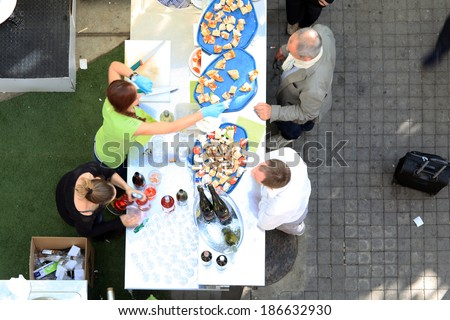MILANO - APRIL 10, 2014: People have lunch during a break at Salone del Mobile, international home furnishing and accessories design exhibition in Milano, Italy.  - stock photo