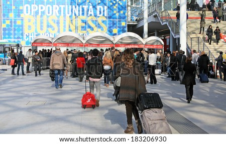 MILANO, ITALY - APRIL 10, 2013: An opportunity of business, people enter at Salone del Mobile, international furnishing accessories exhibition at Rho Fiera Center in Milano, Italy.  - stock photo