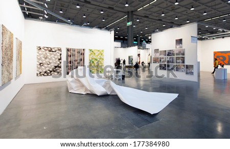 MILANO, ITALY - APRIL 07, 2013: Looking at paintings gallery at MiArt, international exhibition of modern and contemporary art April 07, 2013 in Milan, Italy.  - stock photo