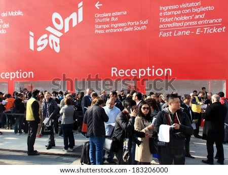 MILANO, ITALY - APRIL 10, 2013: People crowd at reception to but ticket before entering Salone del Mobile, international furnishing accessories exhibition at Rho Fiera Center in Milano, Italy.  - stock photo