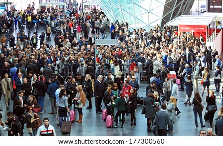 MILANO, ITALY - APRIL 10, 2013: People crowd at the entrance Salone del Mobile, international furnishing accessories exhibition at Rho Fiera Center in Milano, Italy. - stock photo