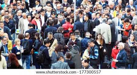 MILANO, ITALY - APRIL 10, 2013: People enter Salone del Mobile, international furnishing accessories exhibition at Rho Fiera Center in Milano, Italy.