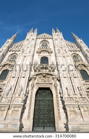 MILANO, ITALY - AUGUST 28: View to the front of the Milan Cathedral on August 28, 2015. Milan is the second-most populous city in Italy and the capital of Lombardy. - stock photo