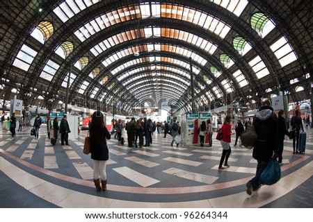 MILANO, ITALY - FEB 28: Commuters in Central railway station on Feb 28, 2012 in Milano, Italy. Every day about 320,000 passengers pass through the station. - stock photo