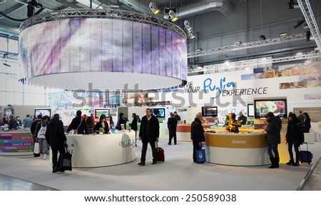 MILANO, ITALY - FEBRUARY 16, 2012: People visit Puglia regional tourism exhibition area during BIT, International Tourism Exchange Exhibition in Milano, Italy. - stock photo