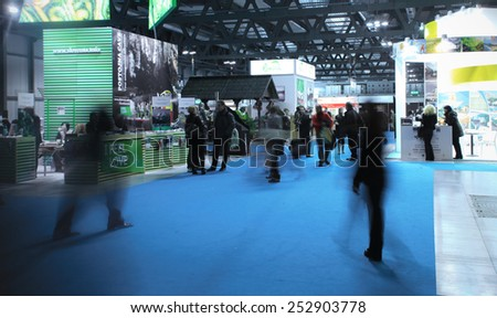 MILANO, ITALY - FEBRUARY 12, 2015: People visit tourism exhibition stands area at BIT, International Tourism Exchange Exhibition in Milano, Italy.