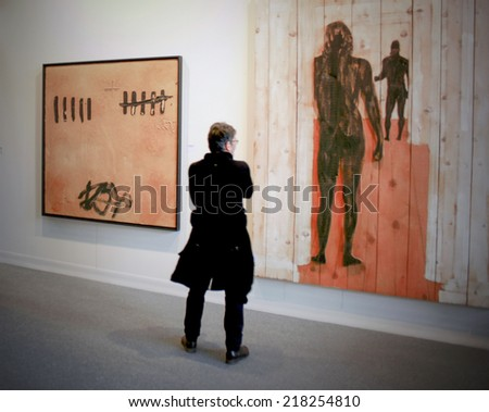 MILANO, ITALY - MARCH 27, 2010: People visit paintings galleries during MiArt, international exhibition of modern and contemporary art in Milano, Italy