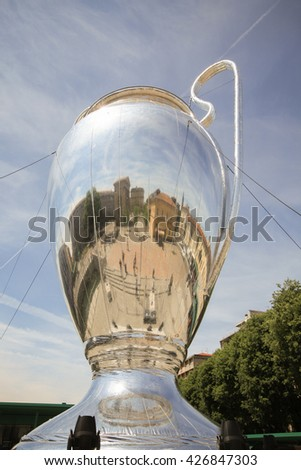 MILANO, ITALY - MAY 25, 2016: A giant cup installation exhibited at Darsena area before FC Real Madrid and Atletico Madrid compete for 2016 UEFA Champions League title at San Siro stadium in Milano.