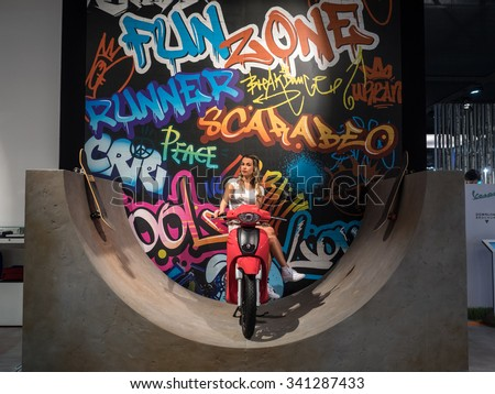 MILANO, ITALY - NOVEMBER 17, 2015: Fun Zone at stand Piaggio at EICMA Milano 2015, the 73rd world exhibition of motorcycling.