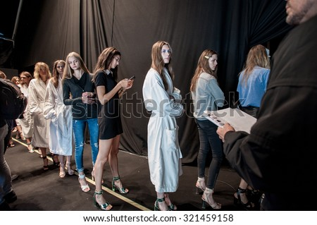 MILANO, ITALY - SEPTEMBER 24, 2015: Models lined up at the backstage of Anteprima before going out on the catwalk for the test of the show at Milan Fashion Week 2015.Fashion Week 2015. - stock photo