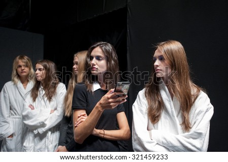 MILANO, ITALY - SEPTEMBER 24, 2015: Models lined up at the backstage of Anteprima before going out on the catwalk for the test of the show at Milan Fashion Week 2015.