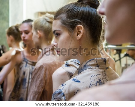 MILANO, ITALY - SEPTEMBER 25, 2015: Models lined up in the backstage of Uma Wang before going out on the catwalk during the presentation of spring-summer collection at Milan Fashion Week 2015. - stock photo