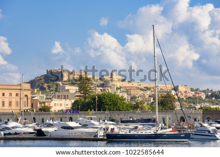 Milazzo, Italy - August 22, 2017: View of the port in Sicilian town with Milazzo Castle in the background