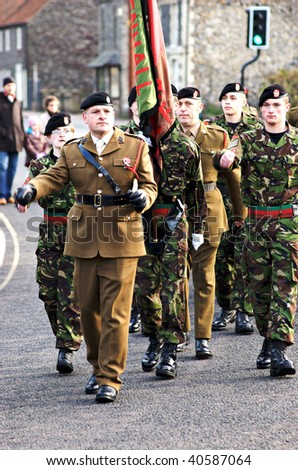 MILDENHALL, UK - NOVEMBER 8: Royal Royal Marines marching during the remembrance sunday parade and ceremony on November 8, 2009 in Mildenhall, UK. - stock photo