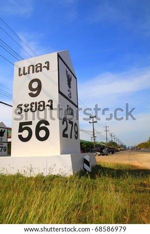 milestone on the road: 9 kilometer to Glang province and 56 Kilometer to Rayong province, Thailand - stock photo