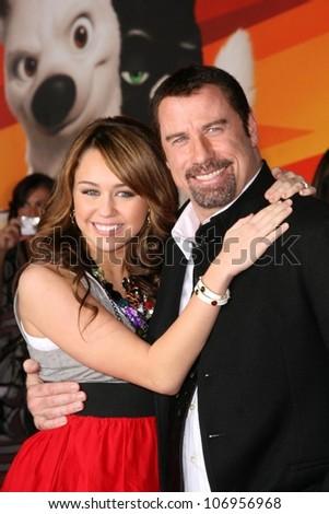Miley Cyrus and John Travolta  at the World Premiere of 'Bolt'. El Capitan Theatre, Hollywood, CA. 11-17-08 - stock photo