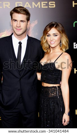 "Miley Cyrus and Liam Hemsworth at the Los Angeles Premiere of ""The Hunger Games"" held at the Nokia Theatre L.A. Live, California, United States on March 12, 2012. - stock photo"