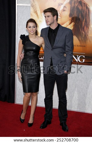 "Miley Cyrus and Liam Hemsworth at the World Premiere of ""The Last Song"" held at the ArcLight Cinemas in Hollywood, California, United States on March 25, 2010."