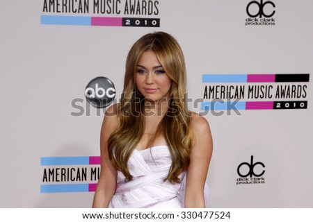 Miley Cyrus at the 2010 American Music Awards held at Nokia Theatre L.A. Live in Los Angeles, USA on November 21, 2010. - stock photo