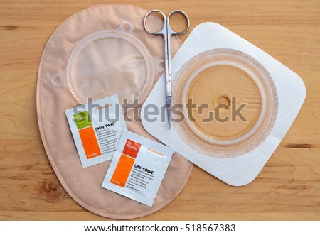 MILFORD, PA - NOVEMBER 19, 2016: Essential skin prep wipes for colostomy care with a colostomy closed end bag, scissors and stomahesive flexible skin barrier