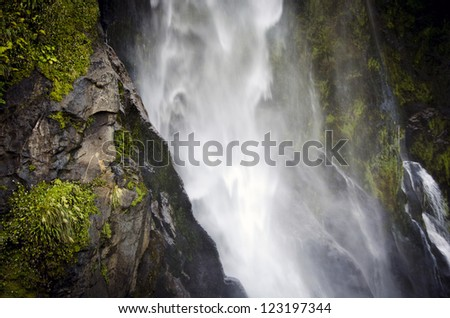 Milford Sound waterfall in New Zealand - stock photo