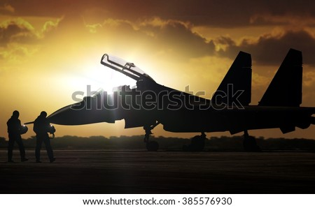 Military Aircraft at airfield on mission standby - stock photo