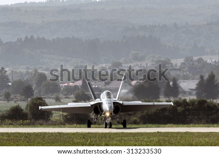 military aircraft on the runway - stock photo