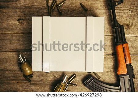 Military ammunition box with a number is AK 47 and grenades. AK-47 ammo box and place for logo. Wooden background and texture blurring - stock photo